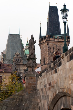 auspices: PRAHA, CZECH REPUBLIC - 22 OCTOBER 2010: Picture of unique Charles Bridge on October 22, 2010. Its construction started in 1357 under the auspices of King Charles IV, and finished in the beginning of the 15th century. Editorial
