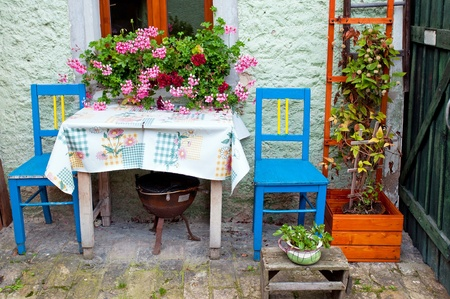 up country: Chairs and table outside the house on patio area. Stock Photo