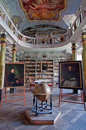 confess: BROUMOV, CZECH REPUBLIC - 1 AUGUST, 2010: Picture of an old library inside the Monastery on August 1, 2010. Visitors can see the unique replica of the Tourine canvas from the year 1651 inside the Monastery. Editorial