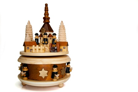 Wooden christmas pyramid with a circle with figurines that turn around. photo