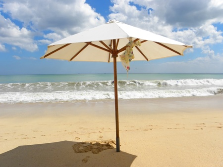Umbrella on tropical beach during the sunny day. Stock Photo - 9167228