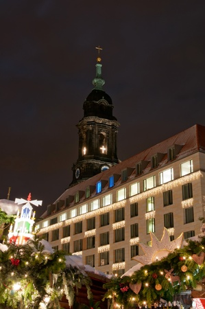 Christmas market in Dresden with tower of Kreuzkirche church. photo