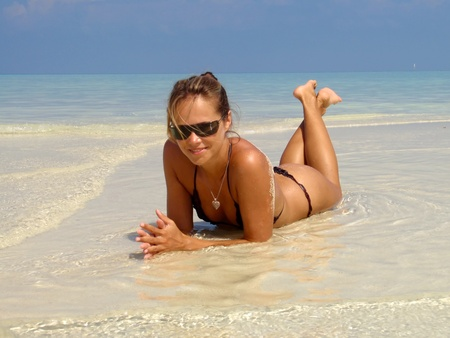 beach babe: Attractive young sexy woman in a sea. Stock Photo