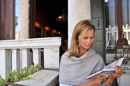 Beautiful young woman in Venice, horizontal shot. photo