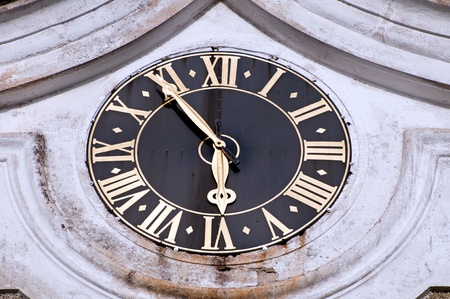 Detail of medieval clock on the outside of the churchl in Broumov, Czech Republic. photo