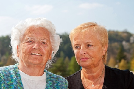 Portrait of mother and daughter taken in the exterior. photo