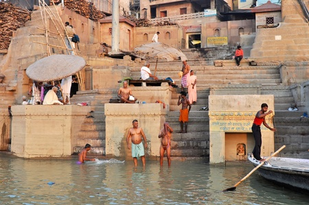 VARANASI, INDIA - 29 OCTOBER, 2009: An unidentified group of Indian people wash themselves in the river Ganga on October 29, 2009.  The holy ritual of washing has to be held every day. Stock Photo - 9512263