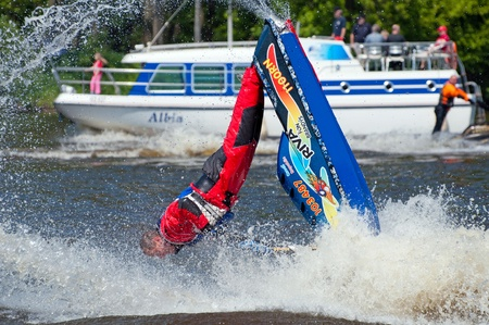 jet skier: ROUDNICE NAD LABEM, CZECH REPUBLIC - 7 MAY, 2011: Unidentified skier in action at Roudnicky Trojuhelnik, jet ski exhibition on May 7, 2011. Trojuhelnik is one of the biggest jet skis and speedboats competitions in the Czech Republic. Editorial