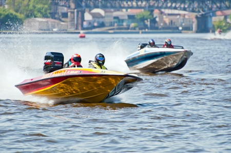 ROUDNICE NAD LABEM, CZECH R. - MAY 7: Unidentified speedboat drivers in action at Roudnicky Trojuhelnik on May 7, 2011 in Roudnice nad Labem, Czech. RT is one of the biggest jet skis & speedboats competitions in the country. Stock Photo - 9638256