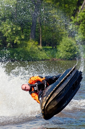 water skier: ROUDNICE NAD LABEM, CZECH REPUBLIC - 7 MAY, 2011: Unidentified skier in action at Roudnicky Trojuhelnik, jet ski exhibition on May 7, 2011. Trojuhelnik is one of the biggest jet skis and speedboats competitions in the Czech Republic. Editorial
