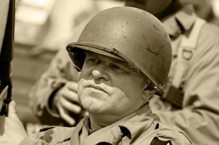 old glory: American veteran in helmet, vintage style (sephia color).