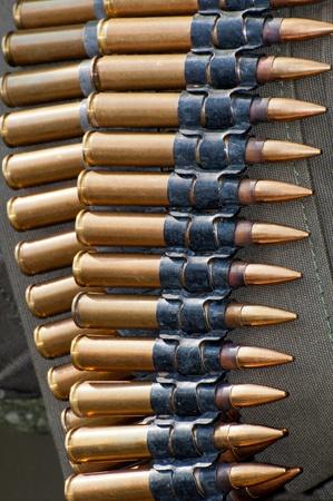 gun shell: Detail of belt with machinegun cartridges, World War II style. Stock Photo