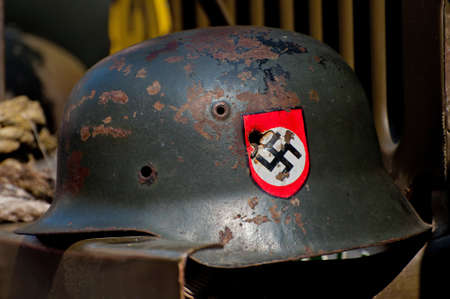 PRAGUE, CZECH REPUBLIC - 29 APRIL: Nazi helmet on American historical Jeep of Old Car Rangers club on April 29, 2011. It is part of reenactment event - the fall of German army in Prague in 1945. .
