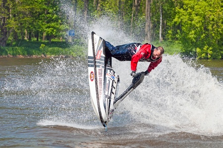 ROUDNICE NAD LABEM, CZECH REPUBLIC - 7 MAY, 2011: Unidentified skier in action at Roudnicky Trojuhelnik (RT) on May 7, 2011 in Roudnice nad Labem, Czech. RT is one of the biggest jet skis and speedboats competitions in the Czech Republic. Stock Photo - 9890199