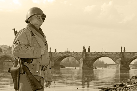 American soldier in Prague, Charles bridge on the background. Stock Photo - 9958619