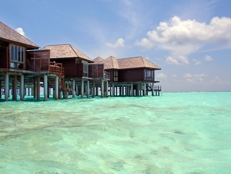 wooden houses: Paradise at Maldives, picture taken from water.