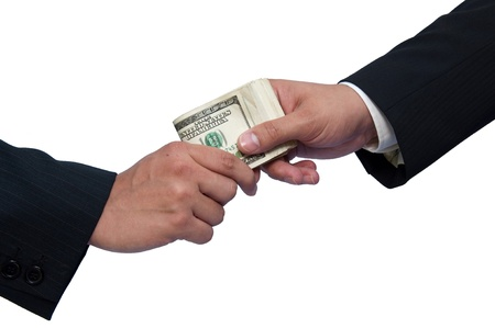Giving a bribe, hands of businessmen on a white background. Stock Photo - 9958670