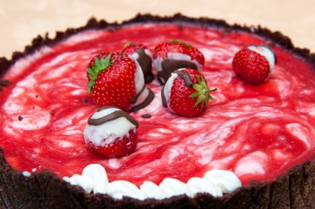 piece of cake: Detail of cake with strawberries and strawberry icing.