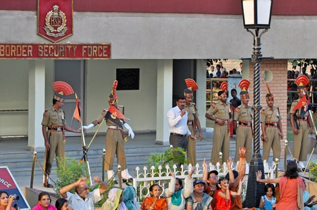 wagah: WAGAH BORDER, INDIA – 25 OCTOBER, 2009: Members of indian Border security force guard during the ceremonial on indo-pakistan border on October 25, 2009, Wagah Border, India. Ceremonial is famous for closing the gate between both states.