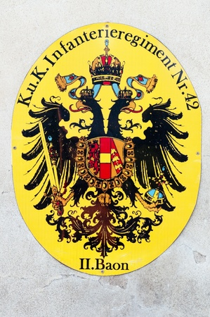 habsburg: TEREZIN, CZECH REPUBLIC - 8 JULY, 2011: Picture of historic coat of arms of the Habsburg monarchy on July 8, 2011 in Terezin, Czech Rep. This type was adapted for use in armed forces and includes number and name of military unit.