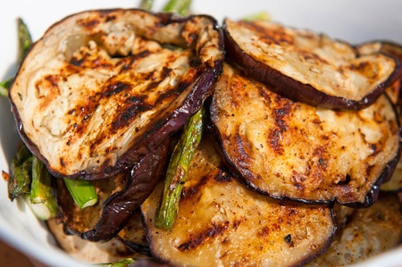 eggplants: Grilled eggplants and asparagus in a white bowl. Stock Photo