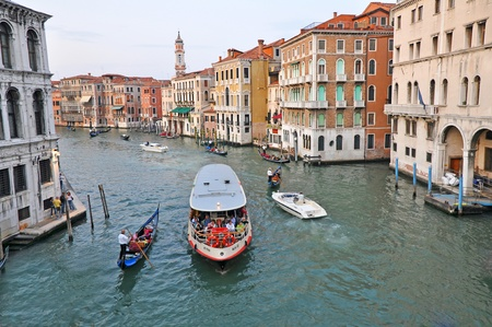 waterbus: VENICE, ITALY - SEPTEMBER 27: Tourists travel by vaporetto on the Grand Channel on September 27, 2009. Vaporetto (waterbus) is the most common way of transportation in Venice.
