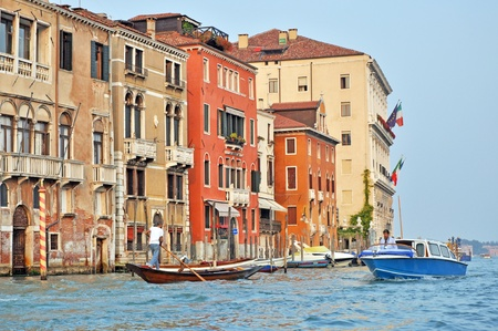 VENICE, ITALY - SEPTEMBER 29: Venetian citizens travel by various boats on the Grand Channel on September 29, 2009. Boats are the most common way of transportation in Venice.