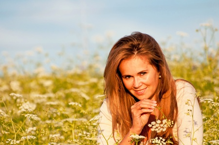 blonde females: Cute caucasian young woman during the sunset. Stock Photo