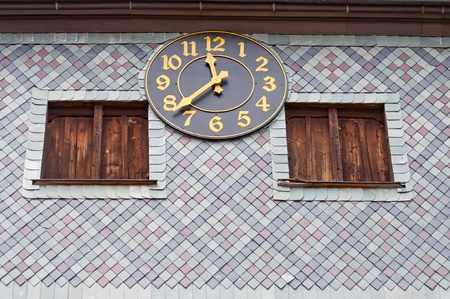 View of medieval clock on the outside of the church in Czermna, Poland. photo