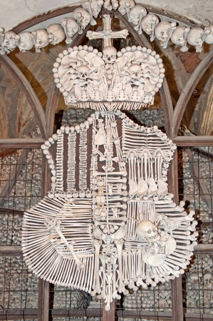 catacomb: Family emblem of Schwarzenberg made of bones in Sedlec Ossuary, Kutna Hora, Czech Republic.