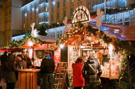 DRESDEN, GERMANY - DECEMBER 20: People enjoy Christmas market in Dresden on December 20, 2010 in Dresden, Germany. It is Germany Stock Photo - 10310771