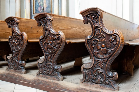 pews: Detailed view of an old wooden church pews.