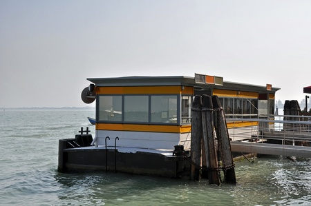 Vaporetto (water bus) stop in Venice, Italy. photo