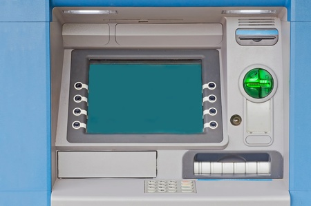 automatic machine: Detailed view of cash machine during the daytime.  Stock Photo