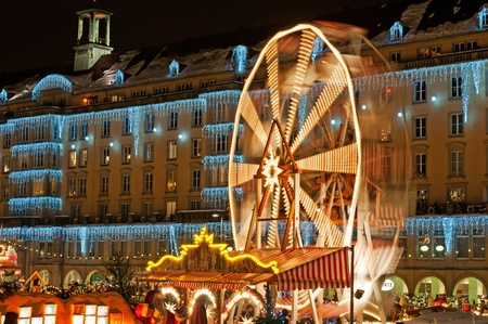 DRESDEN, GERMANY - 20 DECEMBER: An unidentified group of people enjoy Christmas market in Dresden on December 20, 2010 in Dresden, Germany. It is Germany's oldest Christmas Market with a very long history dating back to 1434. Stock Photo - 10499671