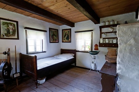 bedlinen: PSTRAZNA, POLAND - JULY 17: View of interior in an old wooden log house on August 17, 2011 in Pstrazna, Poland..