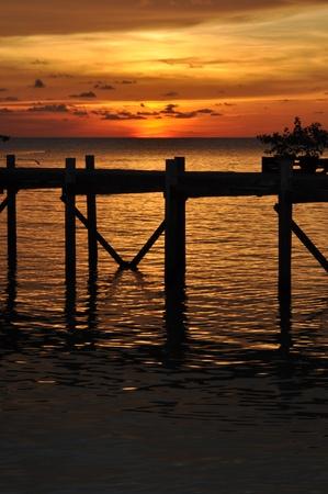 Sea sunset with jetty in Malaysia, Borneo. Stock Photo - 10652908