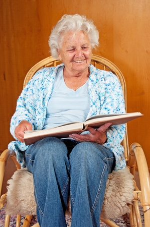 broadly: Portrait of a senior woman in rocking chair. Stock Photo