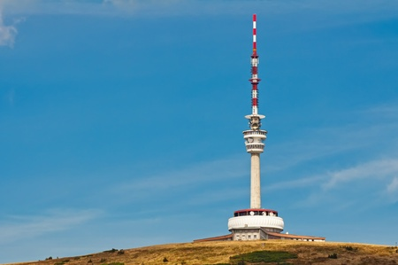 high frequency: Tv and gsm tower on the blue sky