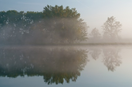Beautiful misty morning on the riverbank. photo