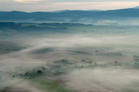 Misty morning in a valley in the Czech Republic. photo