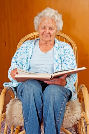 Portrait of a senior woman in rocking chair. photo
