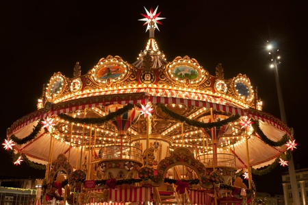 Children merry-go-round at Christmas market in Dresden, Germany.