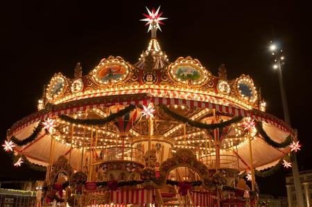 Children merry-go-round at Christmas market in Dresden, Germany.