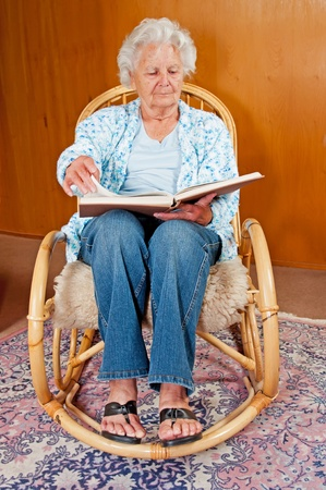 Portrait of a senior woman in rocking chair. Stock Photo - 11231679