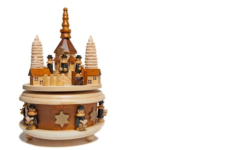 Wooden christmas pyramid with a circle with figurines that turn around. Free copyspace.