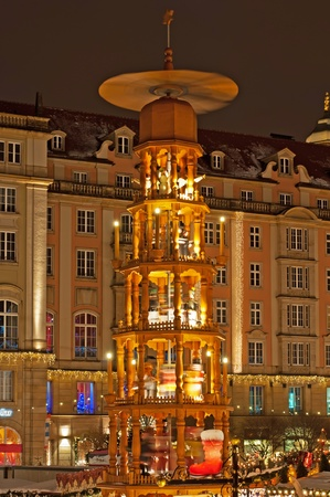 Christmas market in Dresden with eight meter high rotating Christmas pyramid with the life size hand made wooden figures. Stock Photo - 11229747