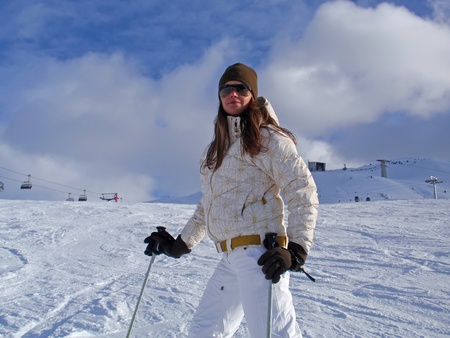 Young woman on ski vacation in the Alps. photo