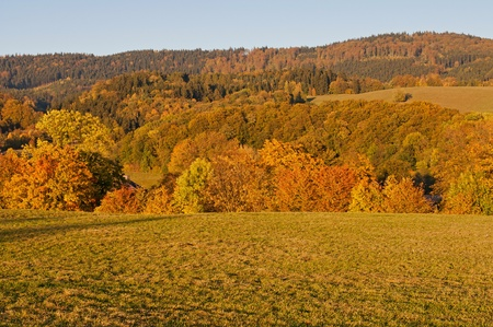 View of an autumn European countryside during the sunset time. photo