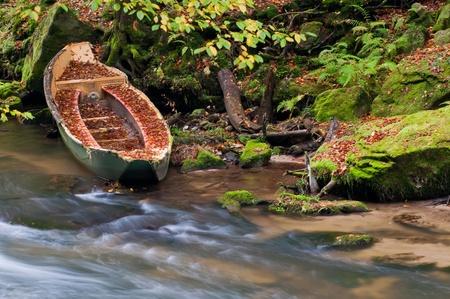 Sunken rowboat on a creek in the Czech-Saxony Switzerland. photo